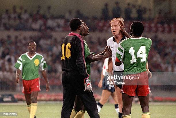 World Cup Quarter Final Naples Italy 1st July England 3 v Cameroon 2 England's Mark Wright is involved in an angry exchange with Cameroon captain...