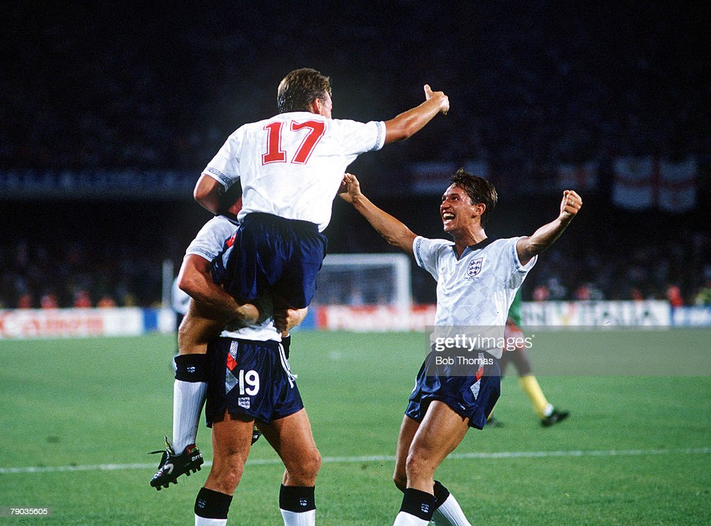 1990 World Cup Quarter Final. Naples, Italy. 1st July, 1990. England 3 v Cameroon 2 (after extra time). England's David Platt (17) celebrates with Paul Gascoigne (19) and Gary Lineker (right) after scoring the first goal. : News Photo