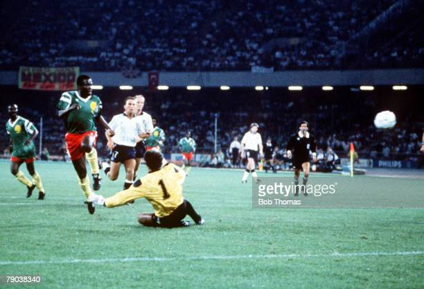 World Cup Quarter Final Naples Italy 1st July England 3 v Cameroon 2 Cameroon's Eugene Ekeke scores a goal past the dive of England goalkeeper Peter...