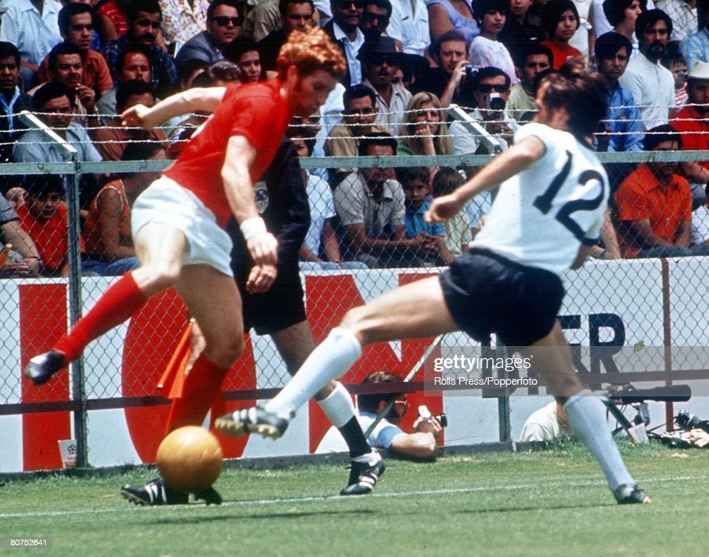World Cup Quarter-Final, 1970 Leon, Mexico. England 2 v West Germany 3. 14th June, 1970. England's Alan Ball battles for the ball with West Germany's Wolfgang Overath during the match. : News Photo