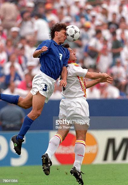 World Cup QuarterFinals Foxboro USA 9th July Italy 2 v Spain 1 Italy's Antonio Benarrivo jumps for a high ball with a Spanish player