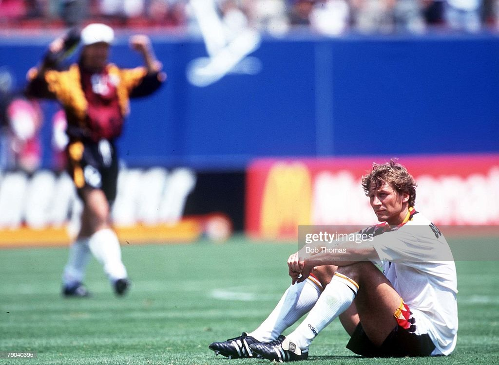 1994 World Cup Quarter-Finals. New Jersey, USA. 10th July, 1994. Bulgaria 2 v Germany 1. Guido Buchwald sits dejected on the pitch after his team were eliminated from the competition : News Photo