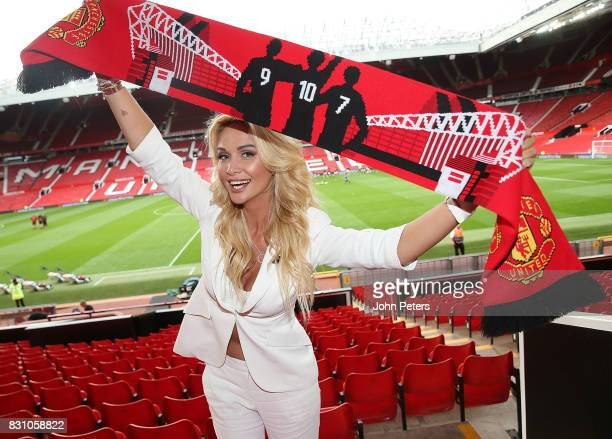 World Cup Russia 2018 ambassador and former Miss Russia Victoria Lopyreva poses with a Manchester United scarf after the Premier League match between...