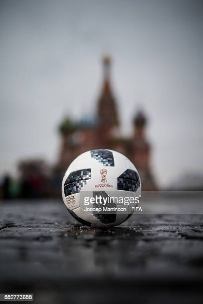 World Cup Russia official adidas match ball Telstar18 is pictured in front of St Basil's Cathedral on the Red Square on November 30 2017 in Moscow...