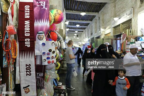 World Cup scarf in maroon and white the national colours of Qatar on sale in the famous cultural market of Souq Waqif Doha Qatar The county of Qatar...