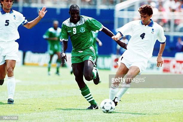 World Cup Second Round Boston USA 5th July Italy 2 v Nigeria 1aet Nigeria's Rasheed Yekini challenges Italy's Alessandro Costacurta