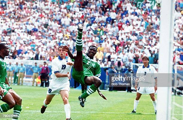 World Cup Second Round Boston USA 5th July Italy 2 v Nigeria 1aet Nigeria's Augustine Eguavoen is watched by Italy's Daniele Massaro
