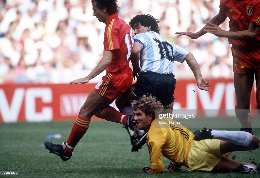 1986 World Cup Semi Final, Azteca Stadium, Mexico, 25th June, 1986, Argentina 2 v Belgium 0, Argentina's Diego Maradona beats Belgian goalkeeper Jean Marie Pfaff and defender Danny Veyt to score the first goal : News Photo