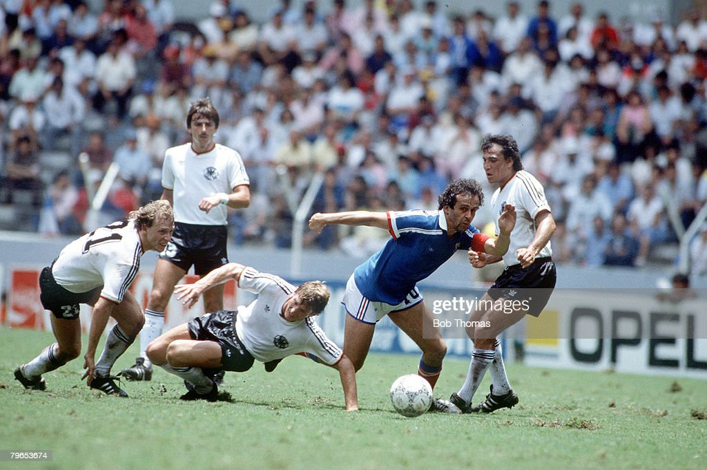 1986 World Cup Semi Final, Guadalajara, Mexico, 25th June, 1986, West Germany 2 v France 0, France's Michel Platini evades the challenges of West Germany's Wolfgang Rolff, Karl Heinz Foerster and Felix Magath : News Photo