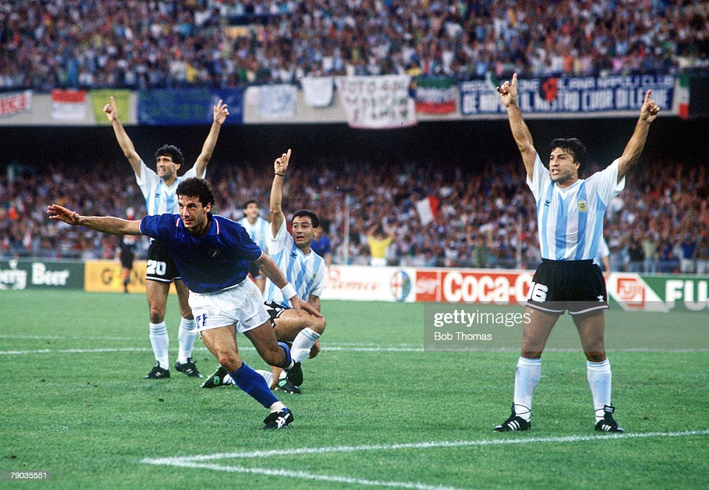 1990 World Cup Semi Final. Naples, Italy. 3rd July, 1990. Italy 1 v Argentina 1 (Argentina win 3-2 on penalties). Italy's Gianluca Vialli races away to celebrate after Salvatore Schillaci scored the first goal as Argentine players protest. : News Photo