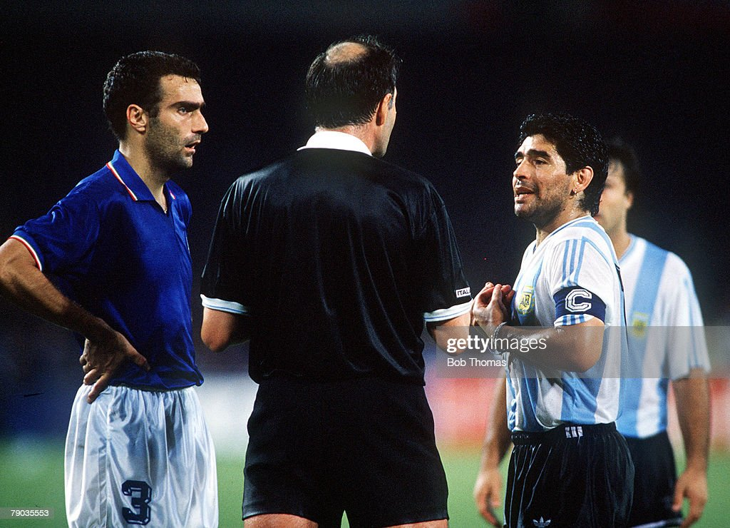 1990 World Cup Semi Final. Naples, Italy. 3rd July, 1990. Italy 1 v Argentina 1 (Argentina win 3-2 on penalties). Italian captain Giuseppe Bergomi and Argentine captain Diego Maradona are spoken to by the referee during the game. : News Photo