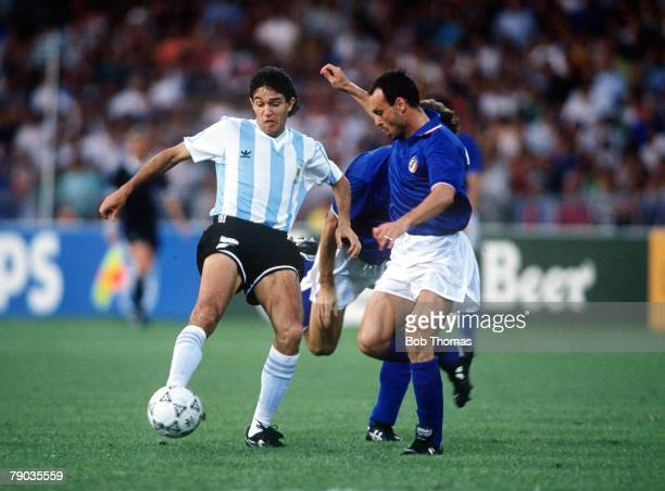 World Cup Semi Final Naples Italy 3rd July Italy 1 v Argentina 1 Argentina's Jorge Burruchaga is challenged for the ball by Italy's Salvatore...