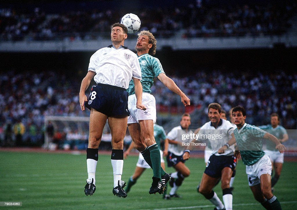 1990 World Cup Semi Final. Turin, Italy. 4th July, 1990. West Germany 1 v England 1 (West Germany win 4-3 on penalties). England's Chris Waddle jumps up for the ball with West Germany's Rudi Voeller. : News Photo