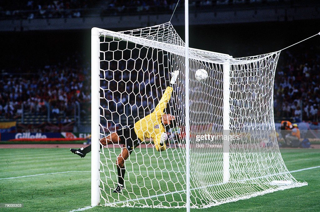 1990 World Cup Semi Final. Turin, Italy. 4th July, 1990. West Germany 1 v England 1. (West Germany win 4-3 on penalties). England goalkeeper Peter Shilton is beaten for the opening goal after an Andreas Brehme free kick was deflected off Paul Parker and l : News Photo