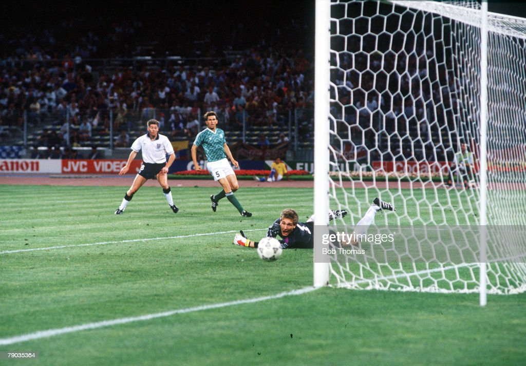 1990 World Cup Semi Final. Turin, Italy. 4th July, 1990. West Germany 1 v England 1 (West Germany win 4-3 on penalties). England's Chris Waddle sees his shot beat West German goakeeper Bodo Illgner but hit the post and rebound back in to play. : News Photo