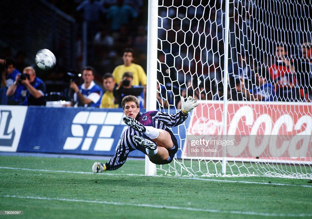 1990 World Cup Semi Final. Turin, Italy. 4th July, 1990. West Germany 1 v England 1 (West Germany win 4-3 on penalties). West German goalkeeper Bodo Illgner saves Stuart Pearce's penalty kick in the shoot-out. : News Photo