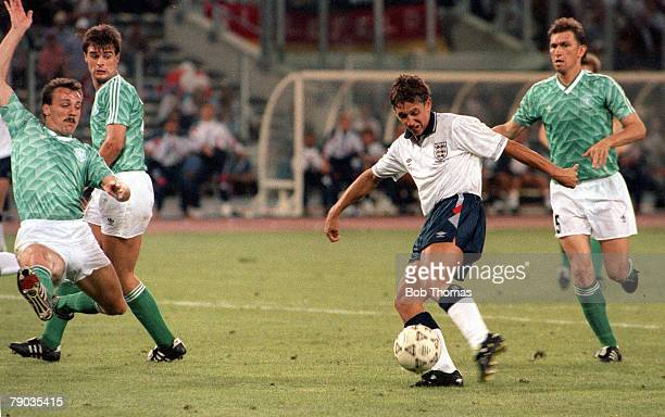World Cup Semi Final Turin Italy 4th July West Germany 1 v England 1 England's Gary Lineker strikes the ball past the lunging challenge of Jurgen...