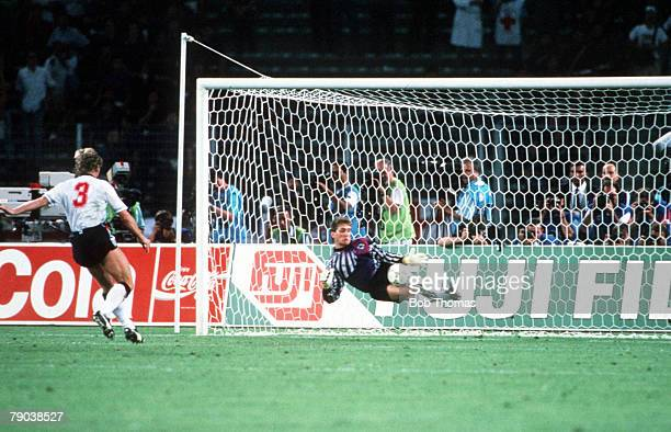 World Cup Semi Final Turin Italy 4th July West Germany 1 v England 1 West Germany's goalkeeper Bodo Illgner dives to save Stuart Pearce's penalty...