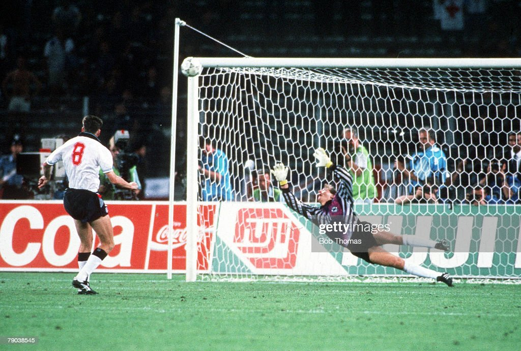 1990 World Cup Semi Final. Turin, Italy. 4th July, 1990. West Germany 1 v England 1 (West Germany win 4-3 on penalties). England's Chris Waddle fires his penalty over the bar past the dive of West German goalkeeper Bodo Illgner in the shoot -out. The pena : News Photo