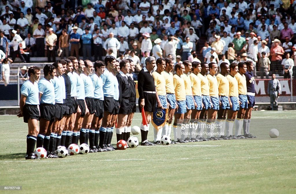 1970 World Cup Semi-Final Guadalajara, Mexico. 17th June, 1970. Brazil 3 v Uruguay 1. The two teams line up with officials as they listen to the national anthems before the match. : News Photo