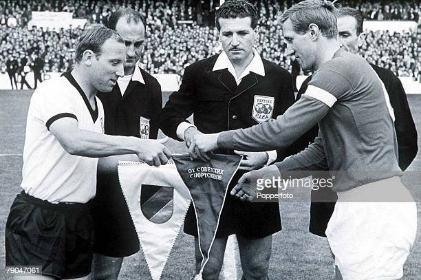 World Cup SemiFinal Liverpool England 25th July West Germany 2 v Soviet Union 1 West Germany's captain Uwe Seeler exchanges pennants with Soviet...