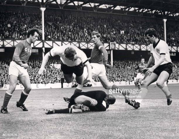 World Cup SemiFinal Liverpool England 25th July West Germany 2 v Soviet Union 1 West Germany's Uwe Seeler takes a flying leap over Soviet Union's...