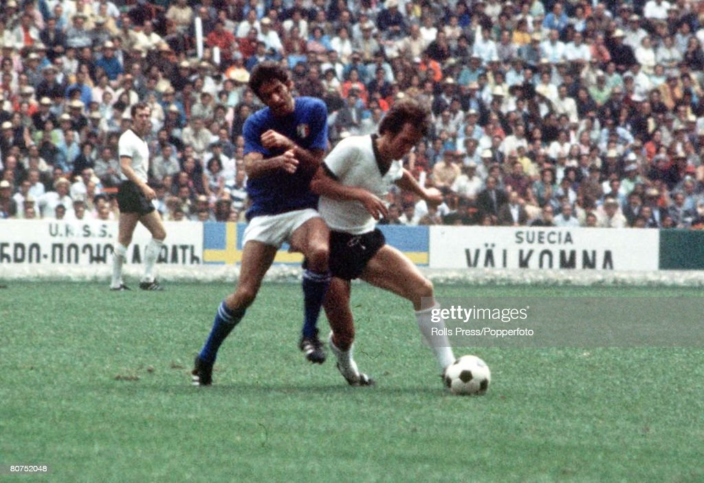 1970 World Cup Semi-Final, Mexico City, Mexico 17th June, 1970. Italy 4 v West Germany 3. An Italian defender and West German attacker fight for the ball during their semi-final match. : News Photo