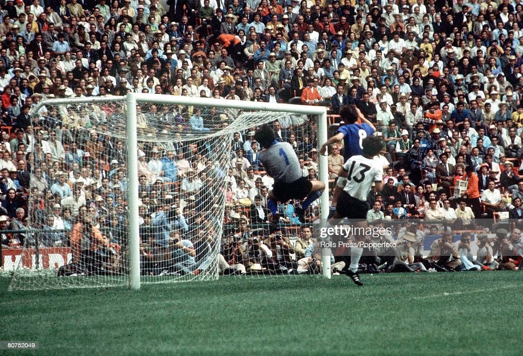 1970 World Cup Semi-Final, Mexico City, Mexico 17th June, 1970. Italy 4 v West Germany 3. West German attacker Gerd Muller causes problems for Italian goalkeeper Enrico Albertosi as he jumps with defender Roberto Rosato (8) during their semi-final match. : News Photo