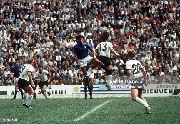 World Cup SemiFinal Mexico City Mexico 17th June Italy 4 v West Germany 3 West German player Gerd Muller jumps for the ball with an Italian defender...