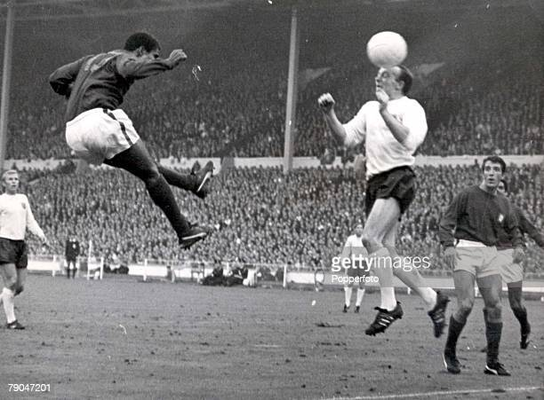 World Cup SemiFinal Wembley Stadium England 26th July England 2 v Portugal 1 England's Nobby Stiles jumps up for the ball with Portugal's Eusebio...