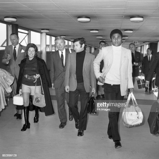 World Cup star Eusebio Silva Ferreira Antonio Simoes and Benfica manager Jimmy Hagan arrive at Heathrow Airport from Lisbon Benfica are due to play...
