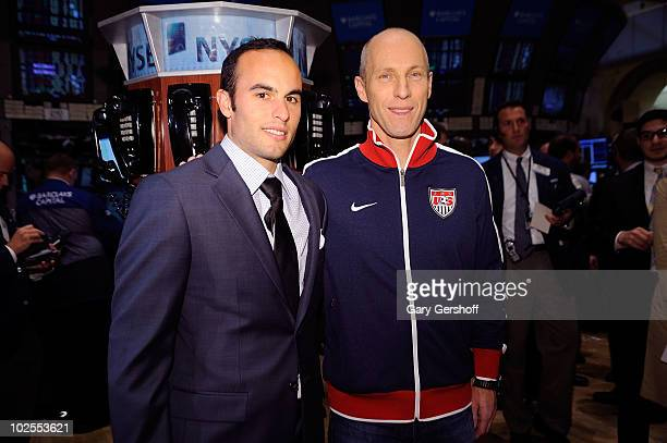 S World Cup Star Landon Donovan and US Men's Natonal Team Coach Bob Bradley seen before ringing the closing bell at the New York Stock Exchange on...