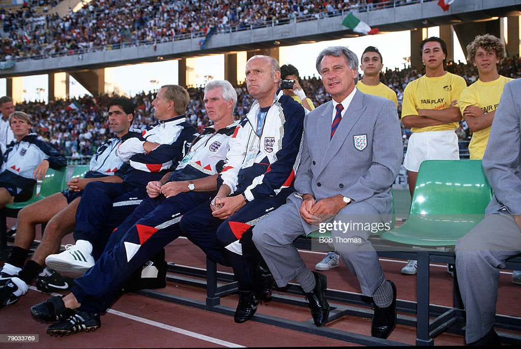 1990 World Cup Third Place Play Off. Bari, Italy. 7th July, 1990. Italy 2 v England 1. Retiring England manager Bobby Robson watches his last game in charge as he sits on the bench with members of his staff. : News Photo