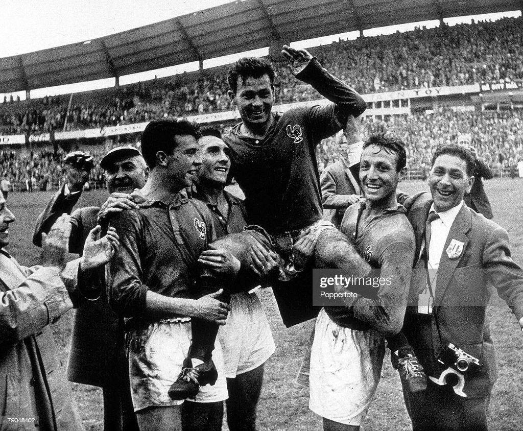 1958 World Cup Third Place Play-Off. Gothenburg, Sweden. 28th June, 1958. France 6 v West Germany 3. France's Just Fontaine is carried by his teammates at the end of the match after scoring four goals to clinch third place for France. : News Photo