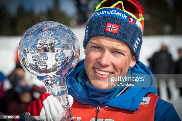 World Cup Winner Johannes Hoesflot Klaebo of Norway celebrates with Sprint Trophy after Sprint Men's Free at Lugnet Stadium on March 16, 2018 in...
