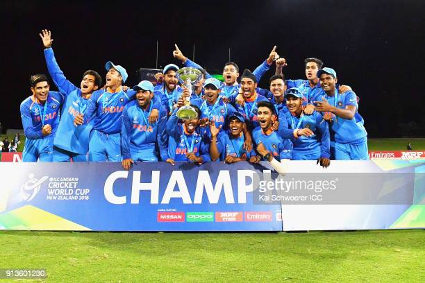 World Cup winners India pose with the trophy after their win in the ICC U19 Cricket World Cup Final match between Australia and India at Bay Oval on...