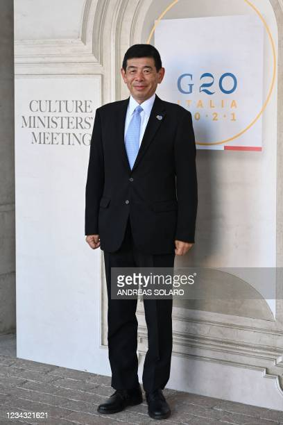 World Customs Organization General Secretary Japan's Kunio Mikuriya poses for photographers as he arrives for the roundtable of the G20 Culture...