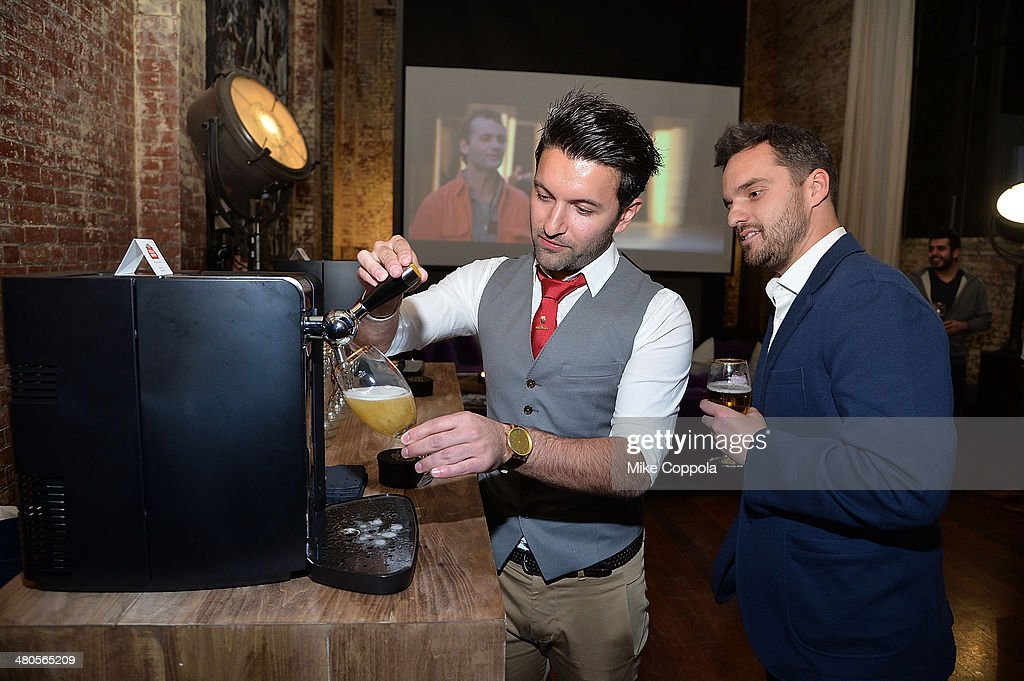 World Draught Master Allaine Schaiko and actor Jake Johnson demonstrate pouring at the Stella Artois PerfectDraft Home Bar celebration event on March 25, 2014 in New York City.