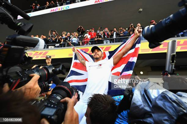 World Drivers Champion Lewis Hamilton of Great Britain and Mercedes GP celebrates with his team after the Formula One Grand Prix of Mexico at...