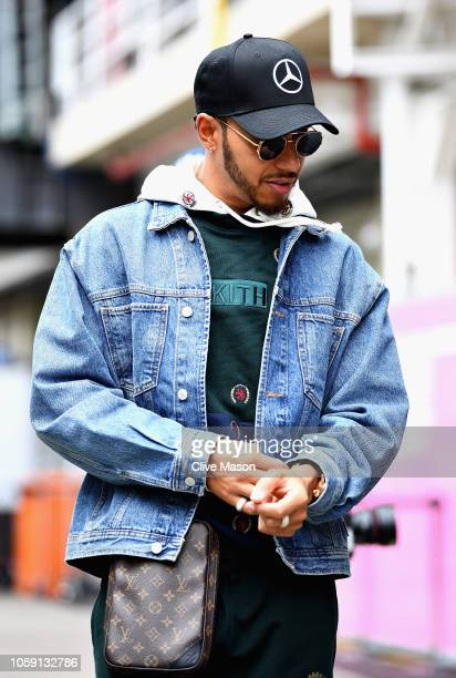 World Drivers Champion Lewis Hamilton of Great Britain and Mercedes GP walks in the Paddock during previews ahead of the Formula One Grand Prix of...