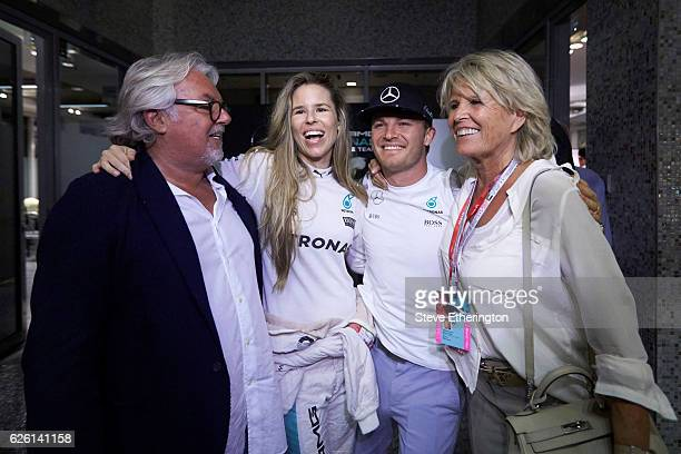 World Drivers Champion Nico Rosberg of Germany and Mercedes GP with father and former F1 Champion Keke Rosberg his wife Vivian Sibold and mother Sina...