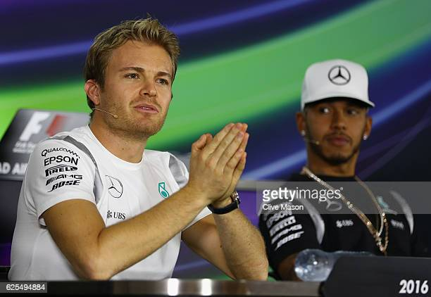 World Drivers Championship contender Nico Rosberg of Germany and Mercedes GP puts his hands together in a press conference with fellow contender...