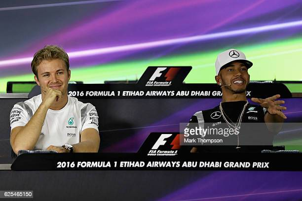 World Drivers Championship contenders Nico Rosberg of Germany and Mercedes GP and Lewis Hamilton of Great Britain and Mercedes GP smile as they...