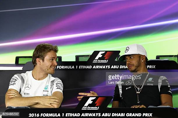 World Drivers Championship contenders Nico Rosberg of Germany and Mercedes GP and Lewis Hamilton of Great Britain and Mercedes GP talk together as...