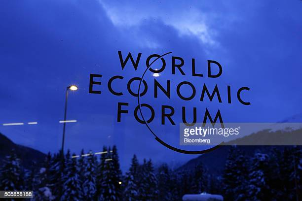A World Economic Forum logo sits on a doorway in the reception hall at the Congress Center as night falls in Davos Switzerland on Wednesday Jan 20...