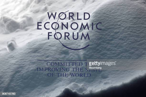 A World Economic Forum sign stands inside the Congress Center as a drift of heavy snow sits behind ahead of the World Economic Forum in Davos...