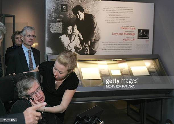 World famous British scientist Stephen Hawking gets help as he tours the Bloomfield Museum of Science in Jerusalem 10 December 2006 Hawking filled...