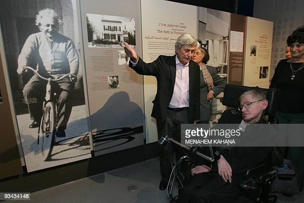 World famous British scientist Stephen Hawking passes by a picture of Albert Einstein as he visit the Bloomfield Museum of Science in Jerusalem 10...