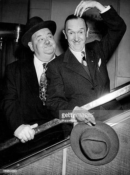 1952 World famous film comedians Stan Laurel and Oliver Hardy are even comics when travelling Here they are seen on arrival on the SS Queen Mary at...