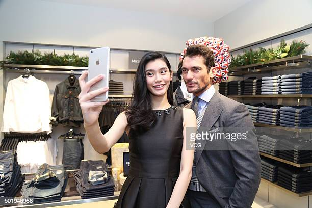 World famous model David Gandy and Chinese model Ming Xi attend an opening event of MarksSpencer on December 18 2015 in Beijing China